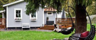 Дом из Швеции в серо-бежевой гамме: хорошая планировка на 63м2 с круглыми окнами